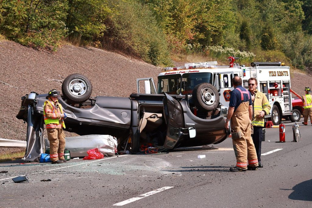 flipped car after a truck accident