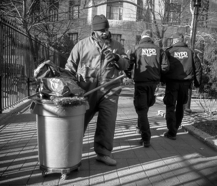 NYC sanitation worker cleaning outside