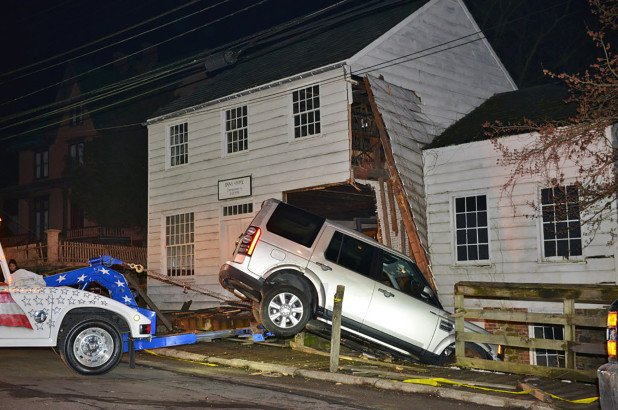 man crashes SUV into building in Staten Island